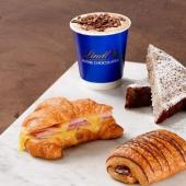 Lindt coffee and croissant image